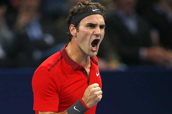Federer of Switzerland reacts against Istomin of Uzbekistan at the Swiss Indoors ATP tennis tournament in Basel